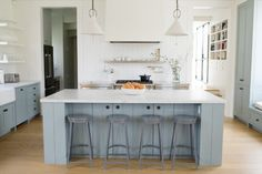 Color & White Kitchen with added storage under island seating.