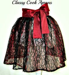 The Summer Trend is SHEER--Ultra feminine lace is one of the hottest trends this season. This apron is from our 'Sheer Elegance Collection' and a vision in double layers of Midnight Black Floral Lace over sheer shimmering Cranberry Red Organza. It features scalloped edges in the back (so you're a vision, coming-and-going) and for a touch of panache, we added a Red Taffeta waist and sash with extra long ties, for a big beautiful back, side or front bow. OMG! Glamor Girl Gorgeous!
