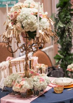 a modern/vintage centerpiece done in gold, cream and pinks, hydrangea and roses