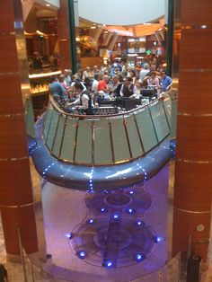 Rising Tide Bar on Oasis of the Seas Bob and I would've had a cocktail on this moving bar, but we couldn't take the smoke being non-smokers. Very cool though!