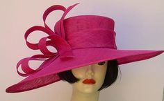 "Dramatic fuchsia pink Derby hat with a 5-6"" brim hat trimmed with matching bow & loops of sinamay. This hat will set you apart in the Derby crowd! Hat-a-tude.com"