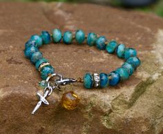 Teal knotted bracelet  Boho beachy cross charm by Mollymoojewels