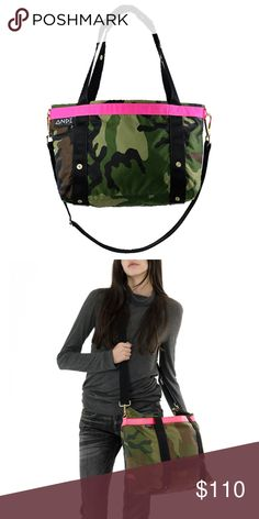 """The ANDI Camo Pop Pink Used, in perfect condition!   Signature Large ANDI is designed and crafted to be an ideal bag!  Perfect for the gym, work or weekend travel!   20.5"""" x 12"""" x 5"""" compacts to 8"""" x 3"""" x 2"""" Handles: 1.5"""" wide with 11.5"""" drop length Material: Nylon – Waterproof coated oxford with heavyweight nylon webbing.  What it fits and more!  15"""" Macbook Sneakers Large glasses case 11"""" Notebook Large beach towel Filled ANDI pocket set Cap Andi New York Bags Totes"""
