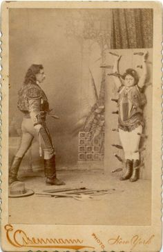 Cabinet card portrait of Sig Arcaris and sister Kate, performing their knife throwing act, 1880s
