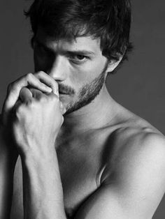 Quiet and calculating. Jamie Dornan plays Christian Grey in the movie. | Fifty Shades of Grey | In Theaters Valentine's Day