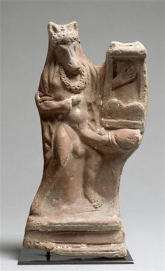 Actor wearing ass's head and playing the cithara (terracotta), from Lower Egypt. Now in the Louvre. Egypt Museum, Louvre, 1st Century, Grand Palais, Ancient Romans, Ancient History, Mythology, Lion Sculpture, Statue