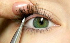 Apply liner to the lash line to give the allusion of false, fuller lashes