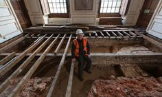 Curator sits in foundations at Hampton Court. Article details: Builders find foundations of rooms once occupied by Queen Anne Boleyn and Queen Jane Seymour.