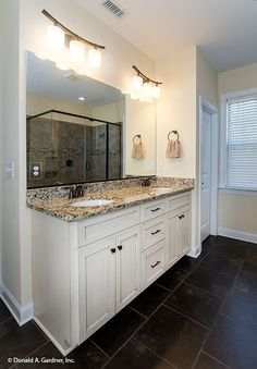 This vanity offers dual sinks for couples! The Lisenby #1220. http://www.dongardner.com/house-plan/1220/the-lisenby. #MasterBathroom #HomePlan #Design