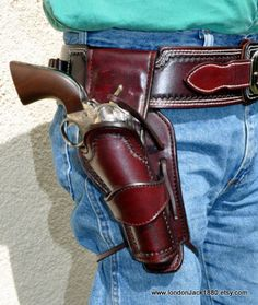 Need this in a 40 waist. Fast draw rig - designed to stand away from the body, have zero retention, and is also forward canted. The belt is also curved for a more custom fit. What more could a cowboy want? Cowboy Holsters, Western Holsters, Gun Holster, Leather Holster, Leather Tooling, Cowboy Action Shooting, Cowboy Gear, Cool Guns, Le Far West