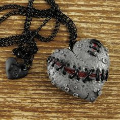 Dead Stitched Zombie Necklace Heart ($21) ❤ liked on Polyvore featuring jewelry, necklaces, accessories, heart charm, heart charm necklace, heart jewelry, heart necklace and clay charms