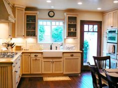 The horseshoe, or U-shaped, kitchen layout has three walls of cabinets and appliances. An evolved version is an L-shaped kitchen with an island forming the third
