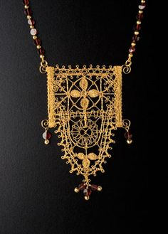 Lenka's metallic bobbin lace - use of wire frame to hold lace taut.