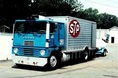 """Petty Blue 1972 Dodge Cabover racecarhauler with STP logos. STP stands for """"Scientifically Treated Petroleum"""". Dodge Diesel, Diesel Cars, Diesel Engine, Vintage Race Car, Vintage Trucks, Antique Trucks, Classic Trucks, Classic Cars, Trailers"""
