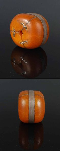 19th century Moroccan amber bead with native silver repairs. Ø 5 cm.  Depth 2.4 cm  ||  600$ ~ sold