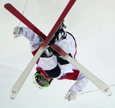 Canada's moguls skier Mikael Kingsbury flies over a jump during freestyle skiing training run at the 2014 Sochi Winter Olympics in Krasnaya Polyna, Russia.