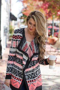 Neon Aztec printed cardigan in neon pink, black, and cream, will look great paired with black skinny jeans and an over sized tee, $42