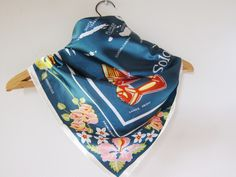 Unusual pretty scarf from foulardfantastic\que  http://www.etsy.com/listing/120432464/soloman-islands-travel-scarf-tropical  Soloman Islands, travel scarf  , tropical flowers , map ,   canoe prow , frigate bird. $28.00, via Etsy.