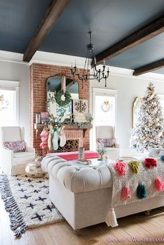 Inside Our Colorful Christmas Holiday Home Tour... Sharing a peek inside our 1905 historic home! living-room-black-ceiling-wood-beams-anthropologie-flocked-christmas-tree-ribbon-how-to-whitewashed-hardwood-floors-chesterfield-sofa-brick-fireplace-alabaster-inkwell-gossamer-veil-sherwin-williams-decorating-ideas