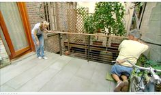 This Old House general contractor Tom Silva installs a cable railing on a deck in Greenwich Village, New York