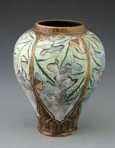 Stephanie Young | Acorns and Oak Leaves | This vase was used for the catalog and posters for the CalmWater Designs show in Cincinnati, Ohio, hosted by Riley Humler, of Antiques Roadshow, and the Humler & Nolan auction house