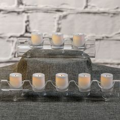 Simple Glass Votive Holder + Flameless LED Votives by Candle Impressions LED candles. These votives come with a 5-hour timer, which makes it so easy to use!