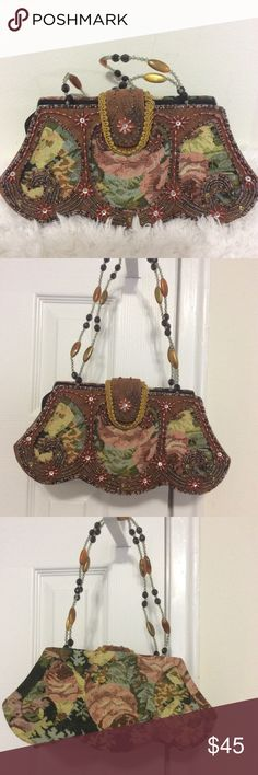 Vintage Beaded Tapestry Handbag WOW, what a beautiful bag! This Vintage Handbag is fantastically made and designed. It has a pretty tapestry base with a type of faux suede overlay with beautifully handmade Beading. Zipper and snap closure. Zipper and snaps work perfectly and no missing beads. Bag has a Patent on the snap. Bags Laptop Bags