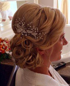 Wedding hair elegant messy side bun updo