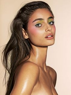 Taylor Hill wears pastel shades including green eyeshadow and pink blush