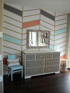 Herringbone pattern accent wall with tape in Coral, blue and grey
