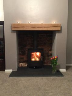Mendip Churchill wood burning and multi fuel stove we installed in Bradford recently.   We knocked out the customers chimney breast to reveal the original brick work at the back, supplied a slate hearth and oak beam.