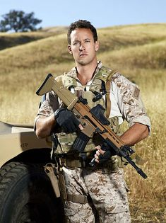 Brent Gleeson ~ Navy SEAL.  SCAR is in multiple colors which I think indicates that this SCAR is a civilian semi-auto only version.