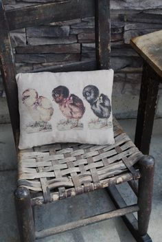 """Prim Easter...old woven chair with a prim """"chicks"""" pillow."""