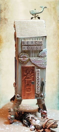 Beach House entrance.  Door is embossed copper. Sculpting is apoxie and paper clays.