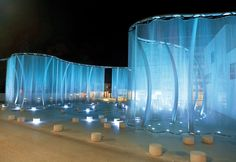 "Project Description: ""SILENT MOVIE"" Luxury crystal glass brand Swarovski graced it's headquarter building in Wattens (Tirol), Austria in a nearly 250 meter long transparent metal curtain. Church Stage, Curtain Lights, Stage Set, Stage Lighting, Stage Design, Set Design, Urban Design, Landscape Lighting, Light Art"