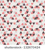 Seamless triangle pattern. Vector background. Geometric abstract texture by Curly Pat, via ShutterStock