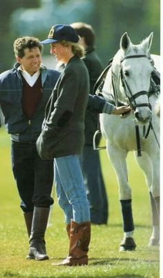 May 02, 1988: Princess Diana at a polo match at Windsor on 2nd May 1988. As patron of the British Lung Foundation, the Princess chose to wear their sweatshirt. Diana, dressed in jeans and a tweed jacket, wears a baseball cap to keep the wind out of her hair. For footwear, the Princess has chosen a tan pair of cowboy boots.