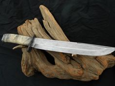 "Hand forged 10"" cable Damascus blade with cable guard and pommel.  The handle is stabilized buckey burl."