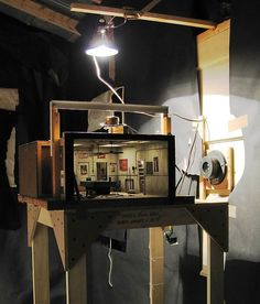 """This is fabulous! """"Mike's Pool Hall"""" (1977), by Michael McMillen, is a mixed media miniature installation made to be viewed through a security peephole.:"""
