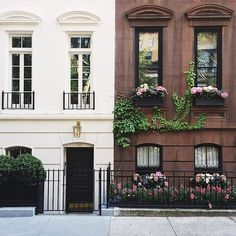 Window box face off on the Upper East Side, Manhattan, NYC , New York , USA  #MakeYouSmileStyle - I love how brownstone apartments look in the summer with their cute ivy and pink flower window box designs!