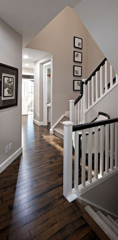 White banister poles with a dark wood handrail and matching stained floor make this space look brilliant, beige/grey walls are the perfect colour to complement the wood- COLOURS FOR HOME Home Renovation, Home Remodeling, Kitchen Renovations, White Banister, Stair Railing, Wood Handrail, Banisters, Railings, Hand Railing