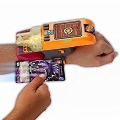 Amazon.com: Dinosaur King -Deluxe Dino Bracer Trading Card Included by Vivid: Toys & Games