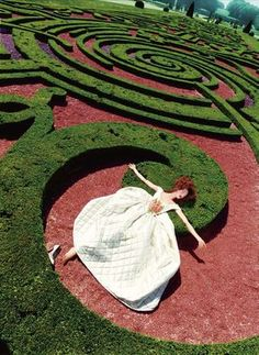 David La Chapelle  I like the pattern of the maze in this image, as well as the placement or form of the lady modelling. The texture of the hedges comes through as well as the floor and her dress, they all fit together in the image nicely.