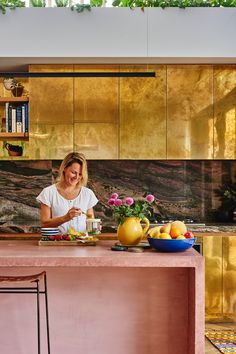 """""""The island bench is pink concrete and was probably the hardest thing to achieve in the house (and therefore the most expensive); it took me a long time to find a concreter willing to give that whacky idea a go!"""""""