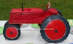 Homemade IH Tractor Graduation Cake: I made this homemade IH tractor graduation cake for my daughter's boyfriend's graduation.  The guy is obsessed with IH tractors and I thought it would