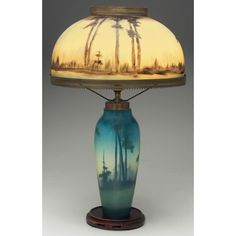 Rookwood lamp by Lenore Asbury, 1917. Beautiful Vellum glaze, with a matching landscape design in the glass lamp shade.