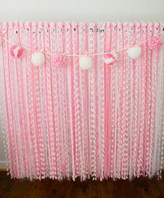 Pink Yarn Photography Backdrop with Pom Pom Garland. $110.00, via Etsy.