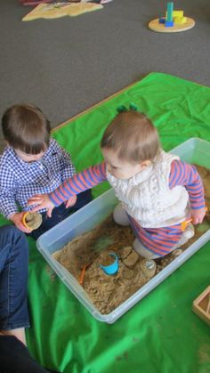 Playing in sand but doing outside with infants and toddlers. Adding different toys and water.