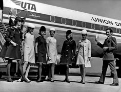 Pierre Cardin in 1968 with his designs for the French airline UTA. In winter, the flight attendants wore navy wool dresses edged in green; in summer, beige gabardine dresses edged in white.