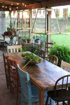 love different chairs! So want to collect different chairs for our outdoor table. want a big wood table with mismatched chairs for the back deck